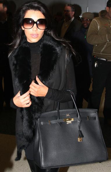 Kim+Khloe+arrive+New+York+Y-XIBoiHU-Al